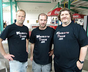 Dave Benton, John Everson and Bill Gagliani wearing the Necrotic Tissue zine t-shirts