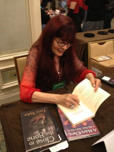 Lucy Taylor signs my copy of Close to the Bone