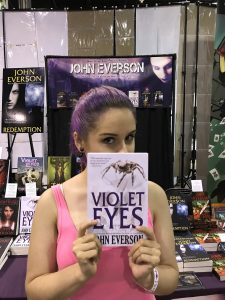 Violet haired girl holds VIOLET EYES - Wizard World Chicago Comic Con 2017