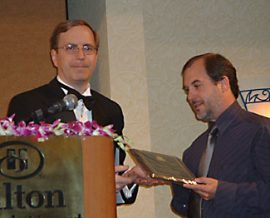 Bev Vincent presents me with the Specialty Press Award on behalf of Delirium Books. Photo by Mary Anne Vincent