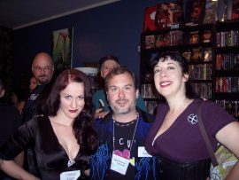 "Feo Amante looks on behind Christa Faust, me and Maria Alexander in our nearly traditional ""sandwich"" shot taken at Dark Delicacies. Photo by Deborah LeBlanc."