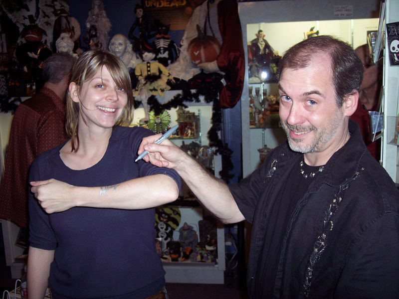 "John Everson ""signs"" Amber Benson at a booksigning in Dark Delicacies in Burbank, CA, 2008."