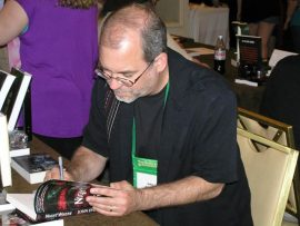 John Everson signs a book at World Horror Convention 2013