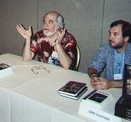 Robert Weinberg (he of the more impressive beard) and me sharing a table at the WHC 2001 mass book signing. (photo courtesy of David Nordhaus)